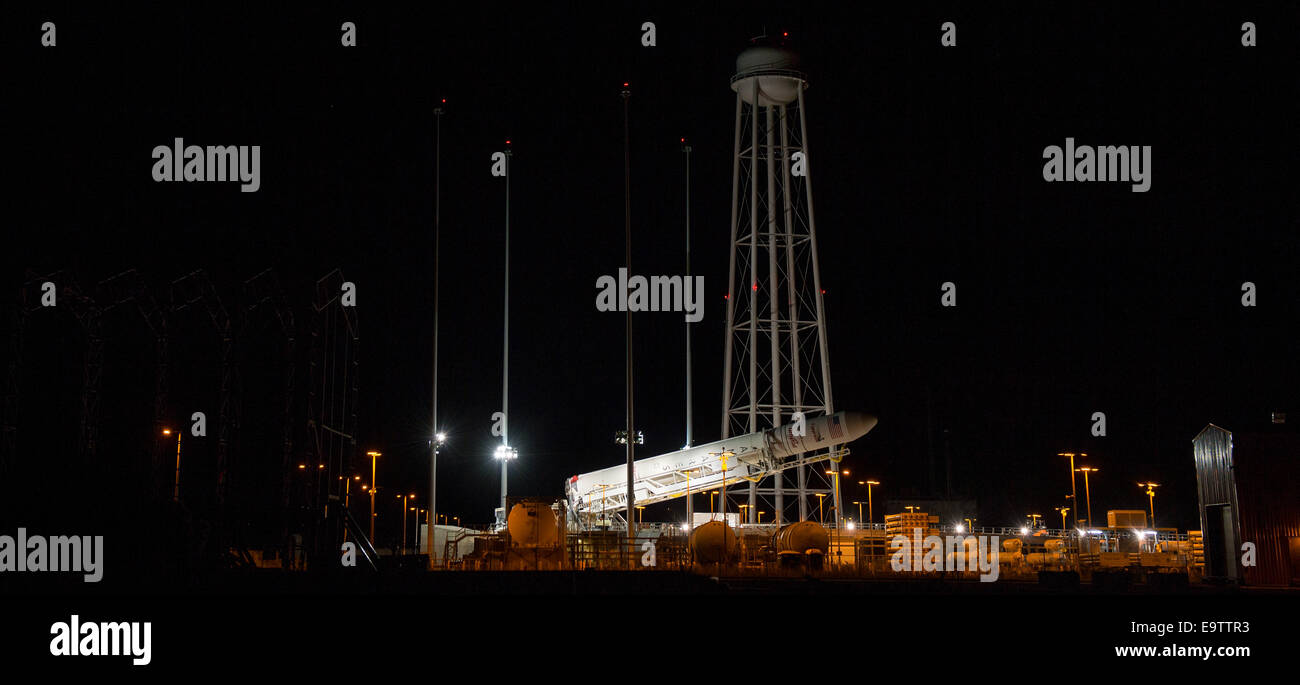 The Orbital Sciences Corporation Antares rocket, with the Cygnus spacecraft onboard, is raised at launch Pad-0A, - Stock Image