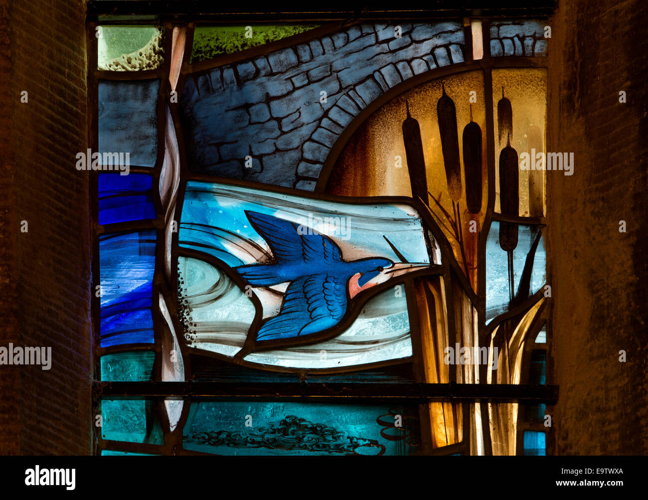 Kingfisher detail of stained glass window by Alfred Fisher, St. Leonard`s Church, Thorpe, Derbyshire, England, UK - Stock Image