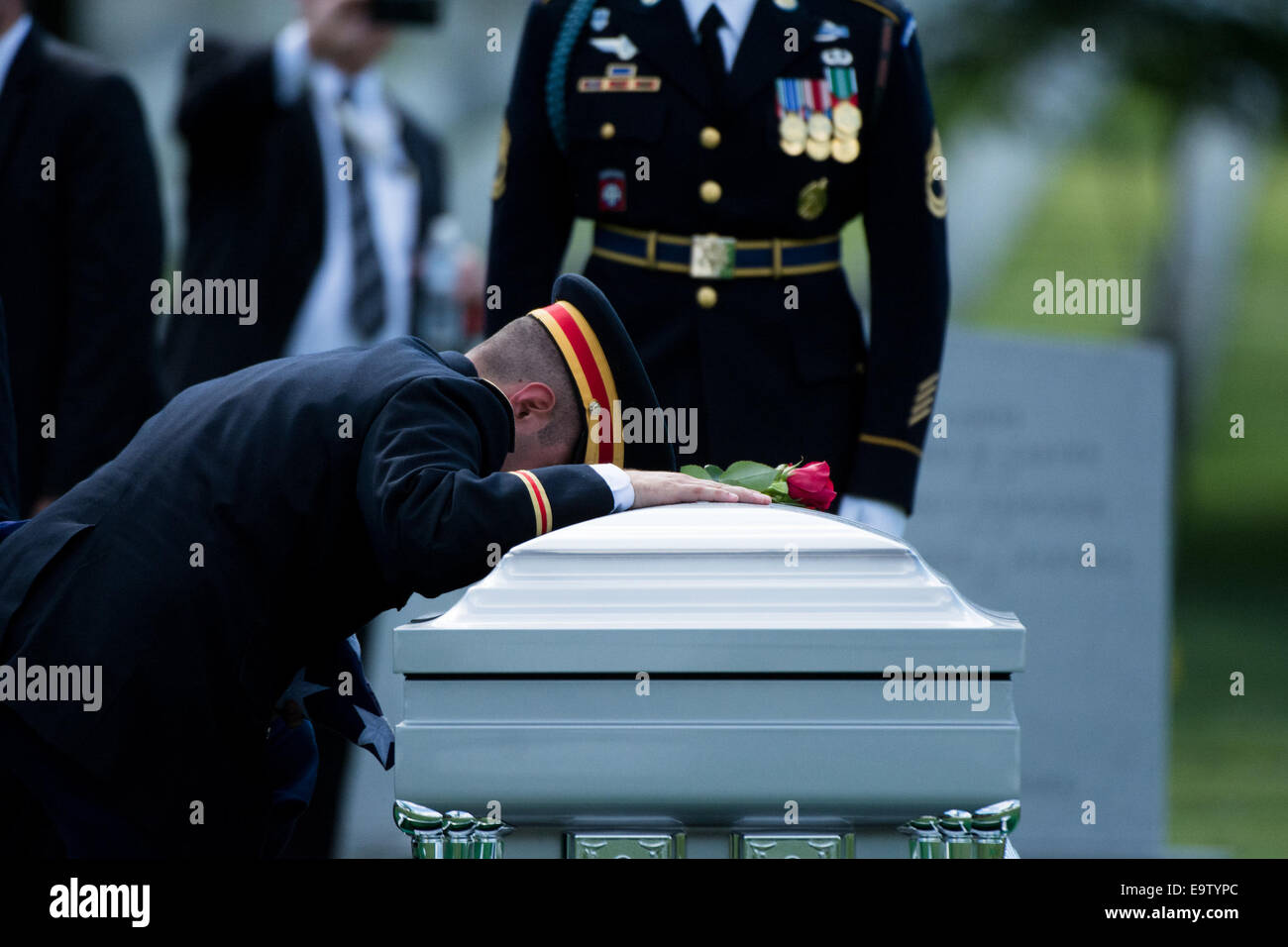 U.S. Army 1st Lt. Matthew Greene, the son Maj. Gen. Harold J. Greene, places a rose on his father?s casket during - Stock Image