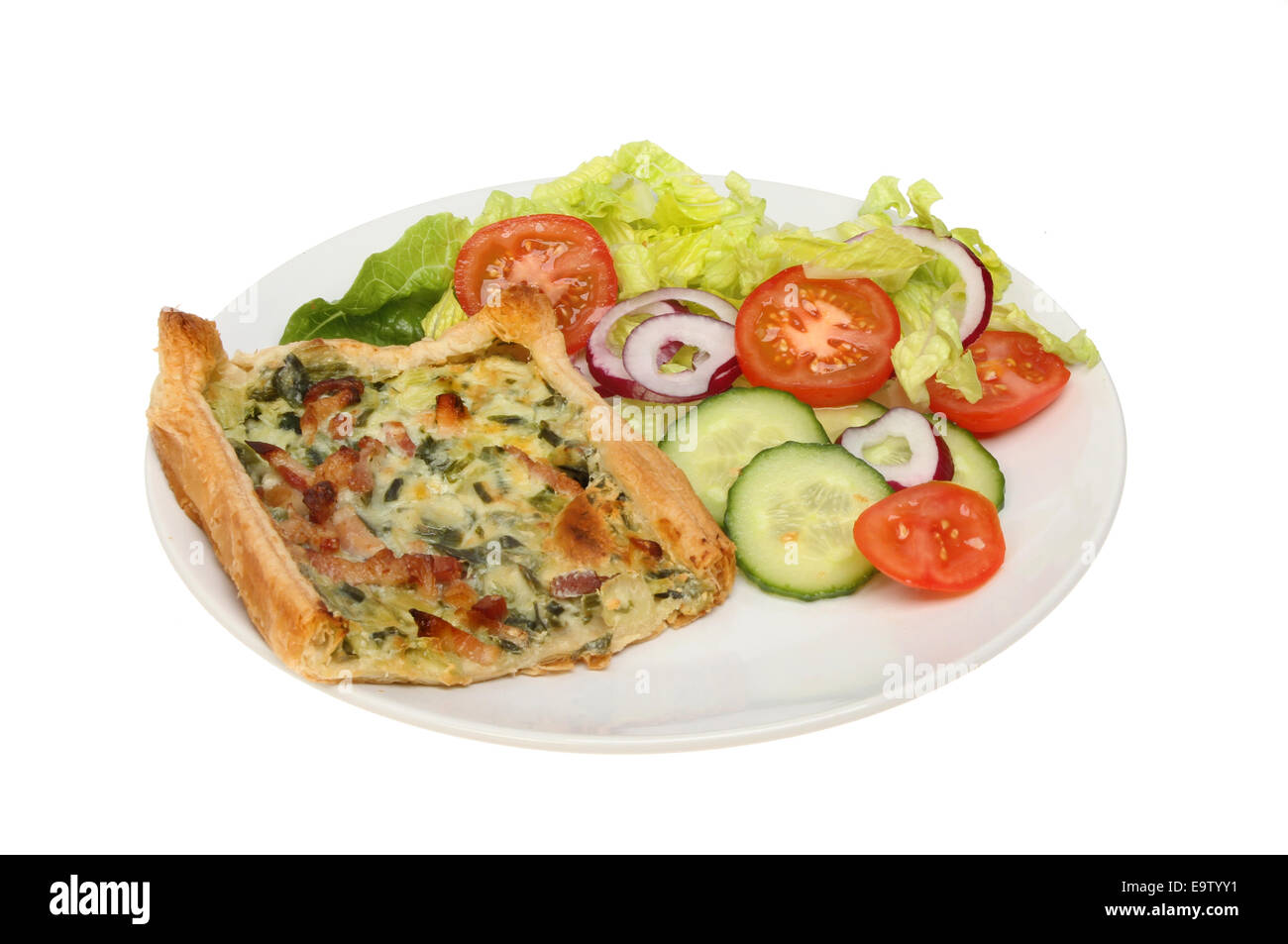 Broccoli and bacon savory tart with salad on a plate isolated against white - Stock Image