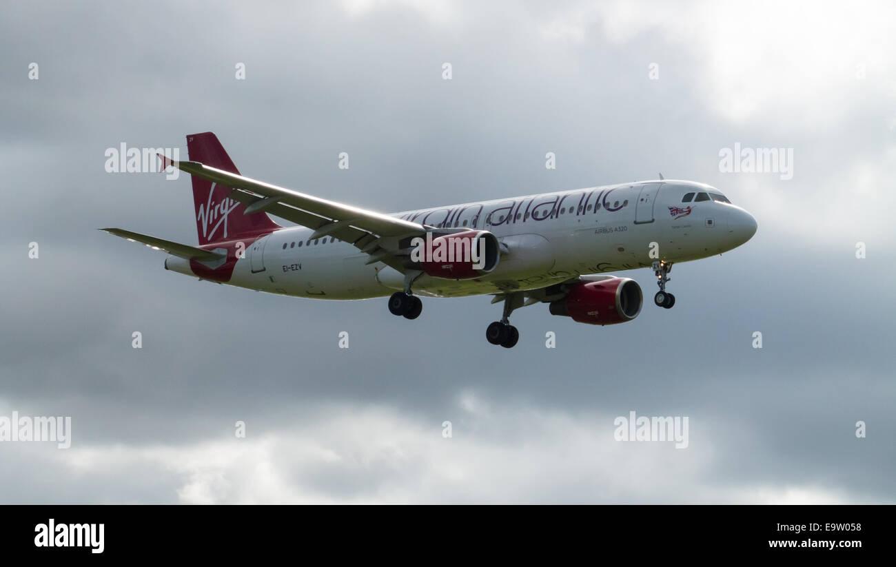 Virgin Atlantic Airbus A320 (EI-EZV) landing to Manchester International Airport. - Stock Image