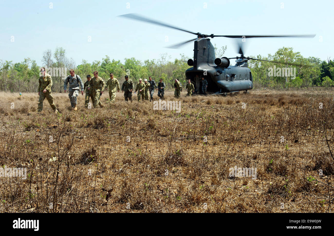 U.S., Australian and Chinese service members disembark from an Australian Army CH-47 Chinook helicopter at a remote - Stock Image