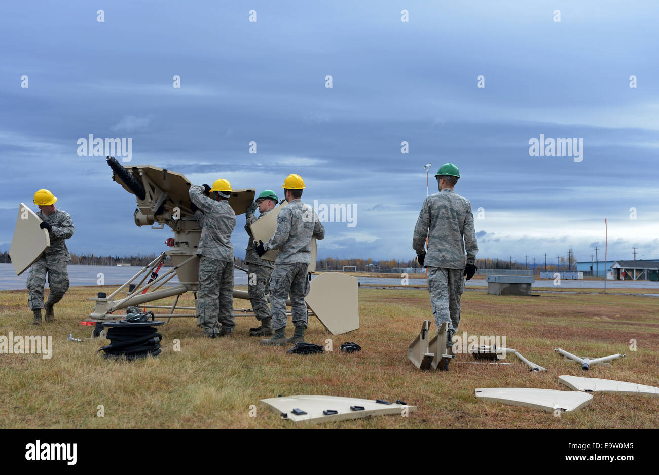 U.S. Airmen with the 52nd Combat Communications Squadron work together to assemble a ground multiband terminal during - Stock Image