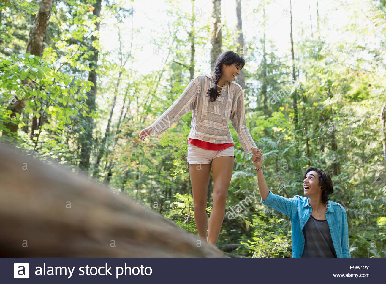 Couple holding hands in woods - Stock Image