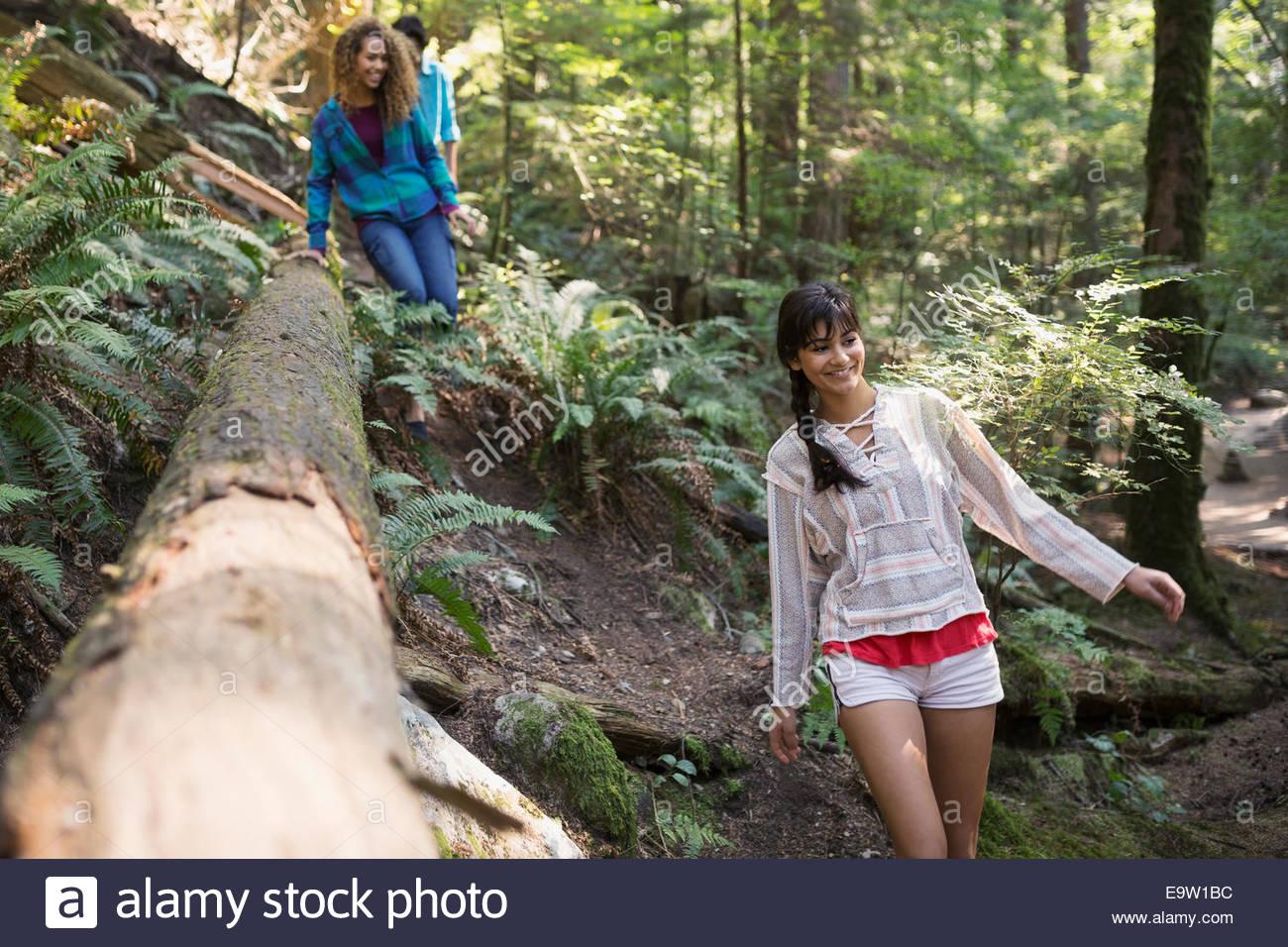 Friends walking in woods - Stock Image