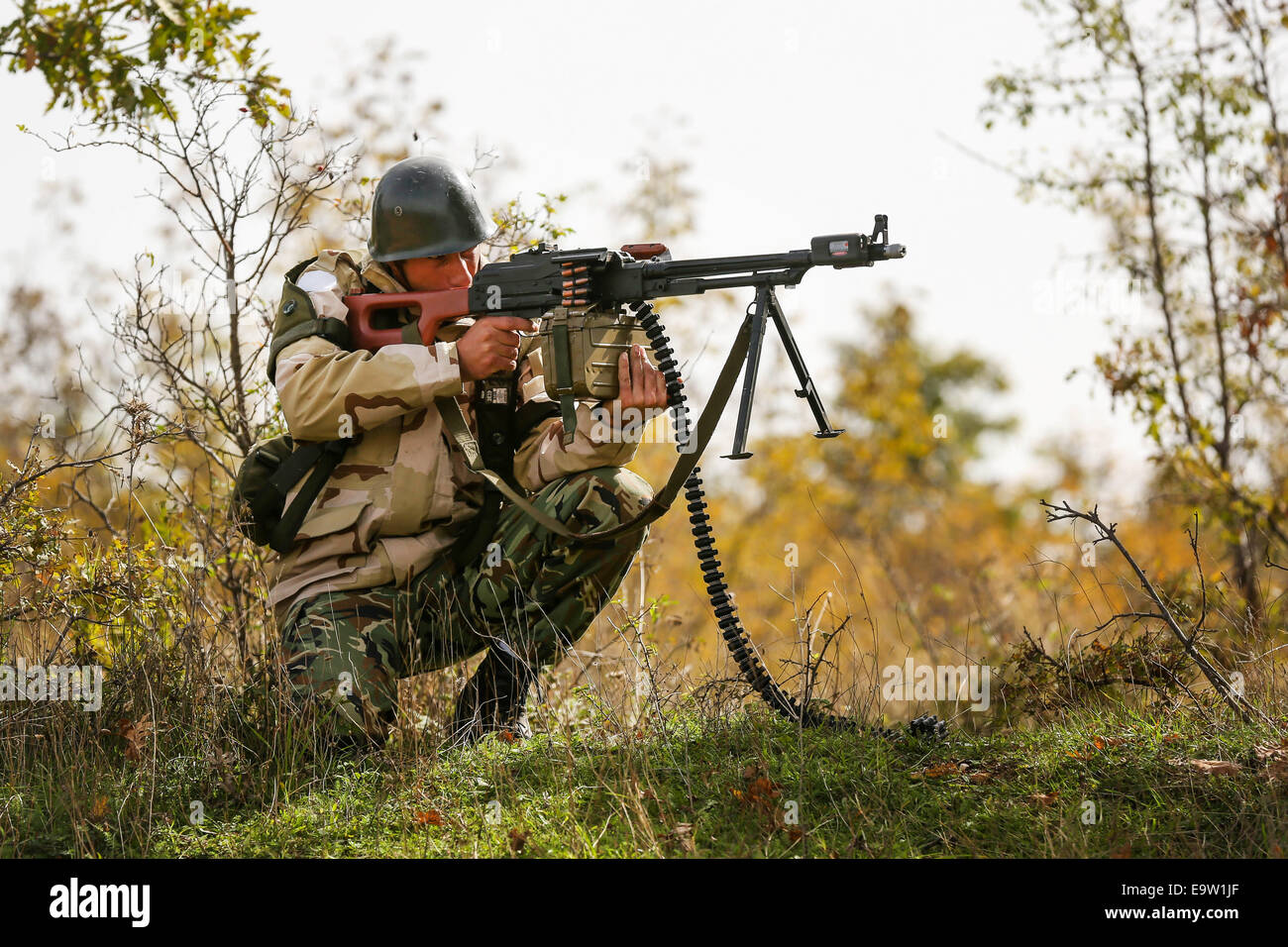 A Bulgarian soldier repels an enemy attack at the Koren Field Training Ground in Bulgaria Oct. 16, 2014, as part Stock Photo