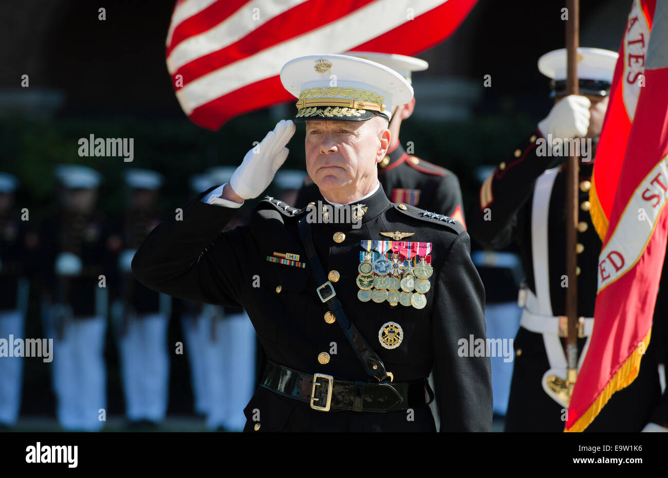 U.S. Marine Corps Gen. James F. Amos, the outgoing commandant of the Marine Corps, salutes during a change of command - Stock Image