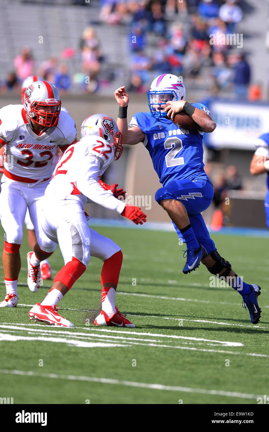 Kale Pearson, No. 2, a quarterback with the U.S. Air Force Academy Falcons, tries to avoid Markel Byrd, No. 22, Stock Photo