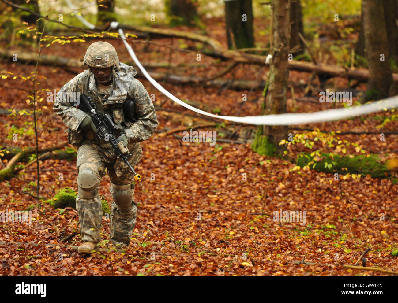 A U.S. Soldier assigned to the 2nd Cavalry Regiment competes with Soldiers from other units in a land navigation - Stock Image