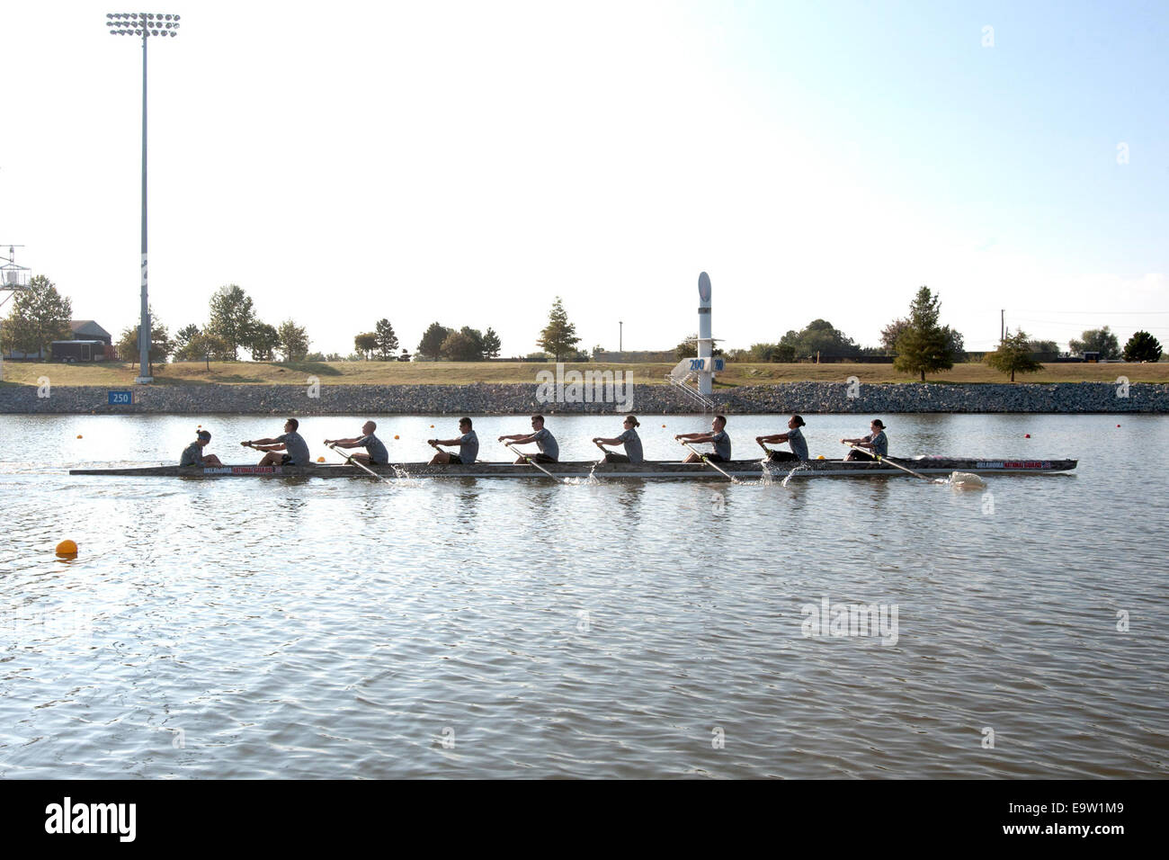 U.S. Soldiers with the Oklahoma Army National Guard rowing team practice rowing on the Oklahoma River Oct. 21, 2014, Stock Photo