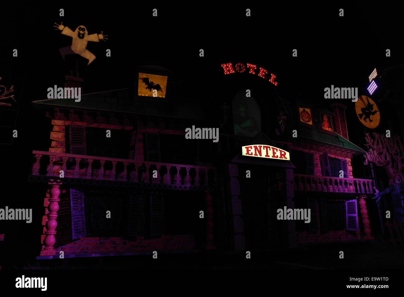 Night view purple lights Haunted Hotel Tableau, with spooky images and holograph Frankenstein's Monster, Blackpool - Stock Image