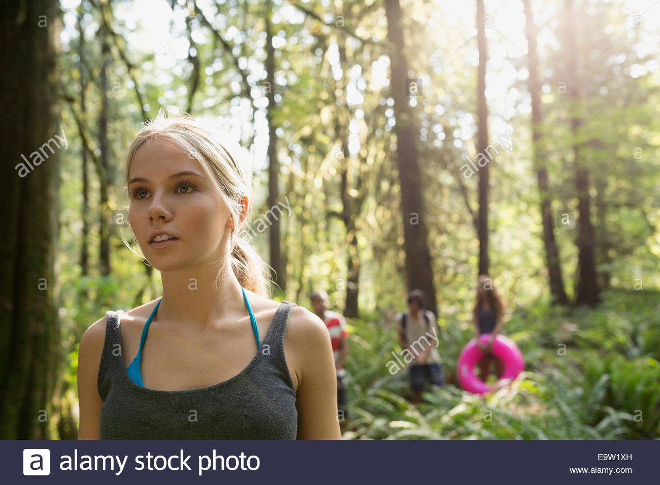 Serious young woman in woods - Stock Image