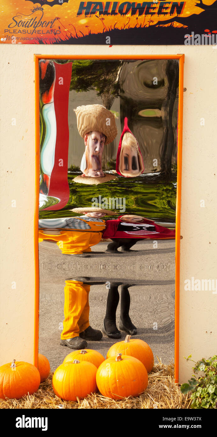 Fun and interesting reflected images in distorting convex & concave mirrors giving repetitive reflections; an - Stock Image