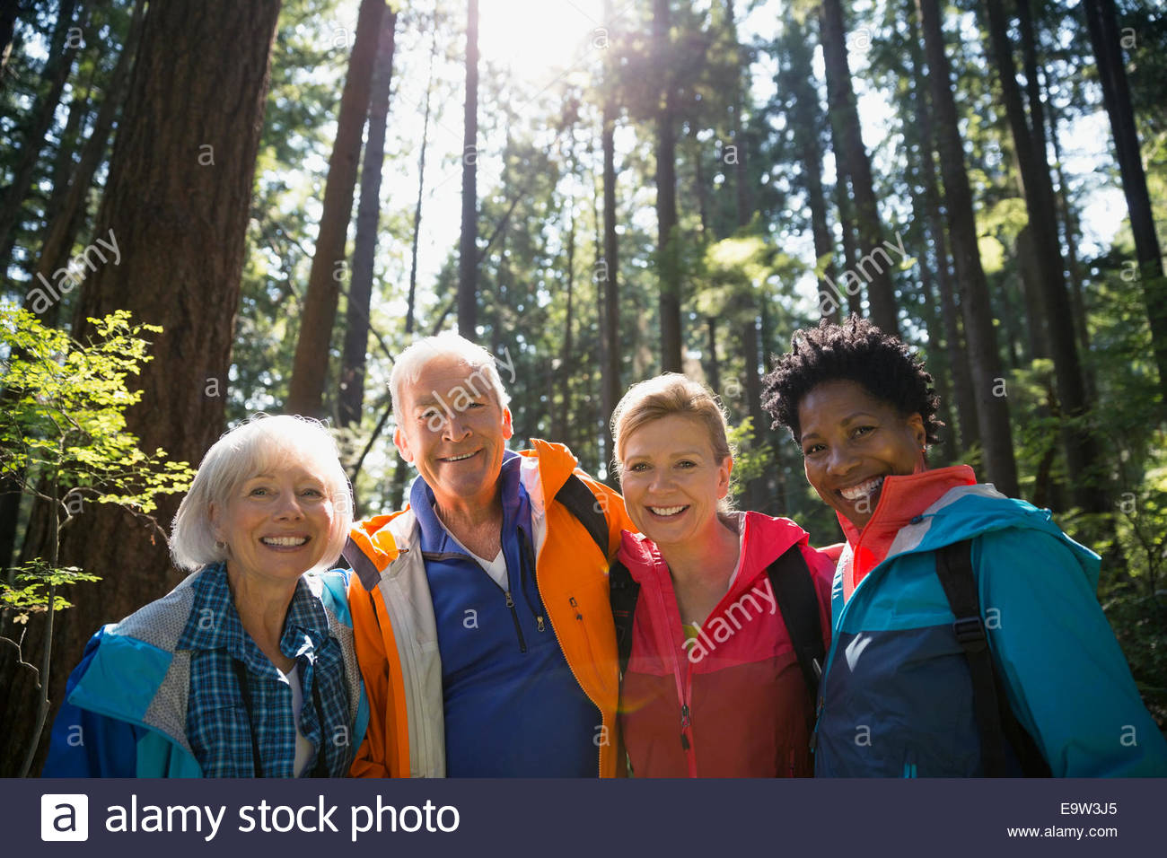 Portrait of friends in sunny woods Stock Photo