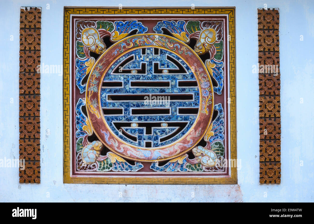 Vietnam Hué Citadel: Longevity symbol as window in wall of palace. - Stock Image