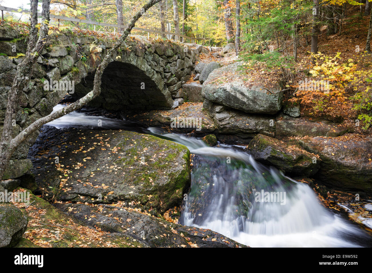 Gleason Falls Bridge which spans Beard Brook in Hillsborough, New Hampshire USA during the autumn months. - Stock Image