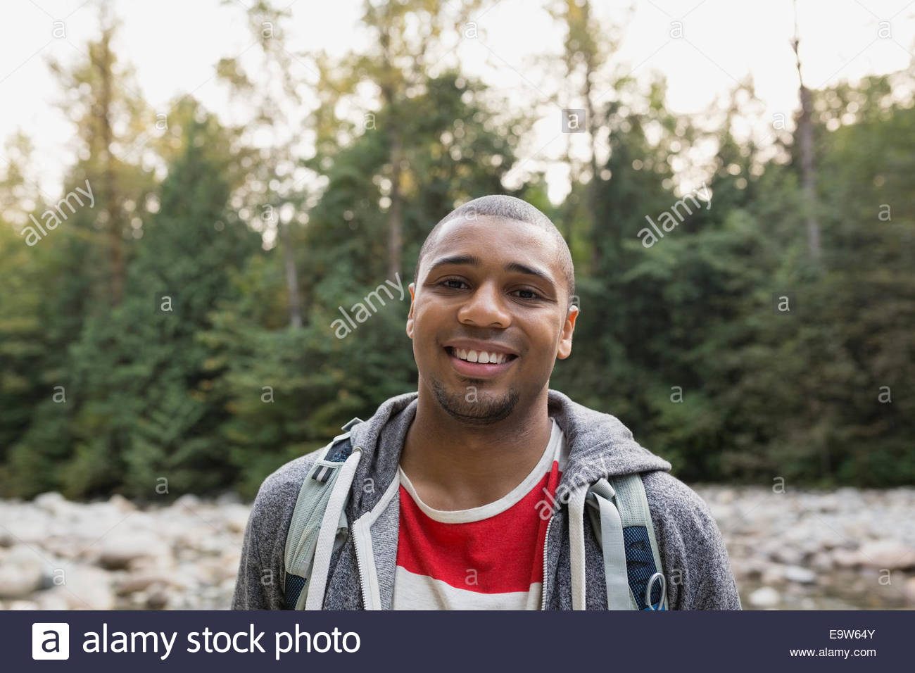 Portrait of smiling man in woods - Stock Image