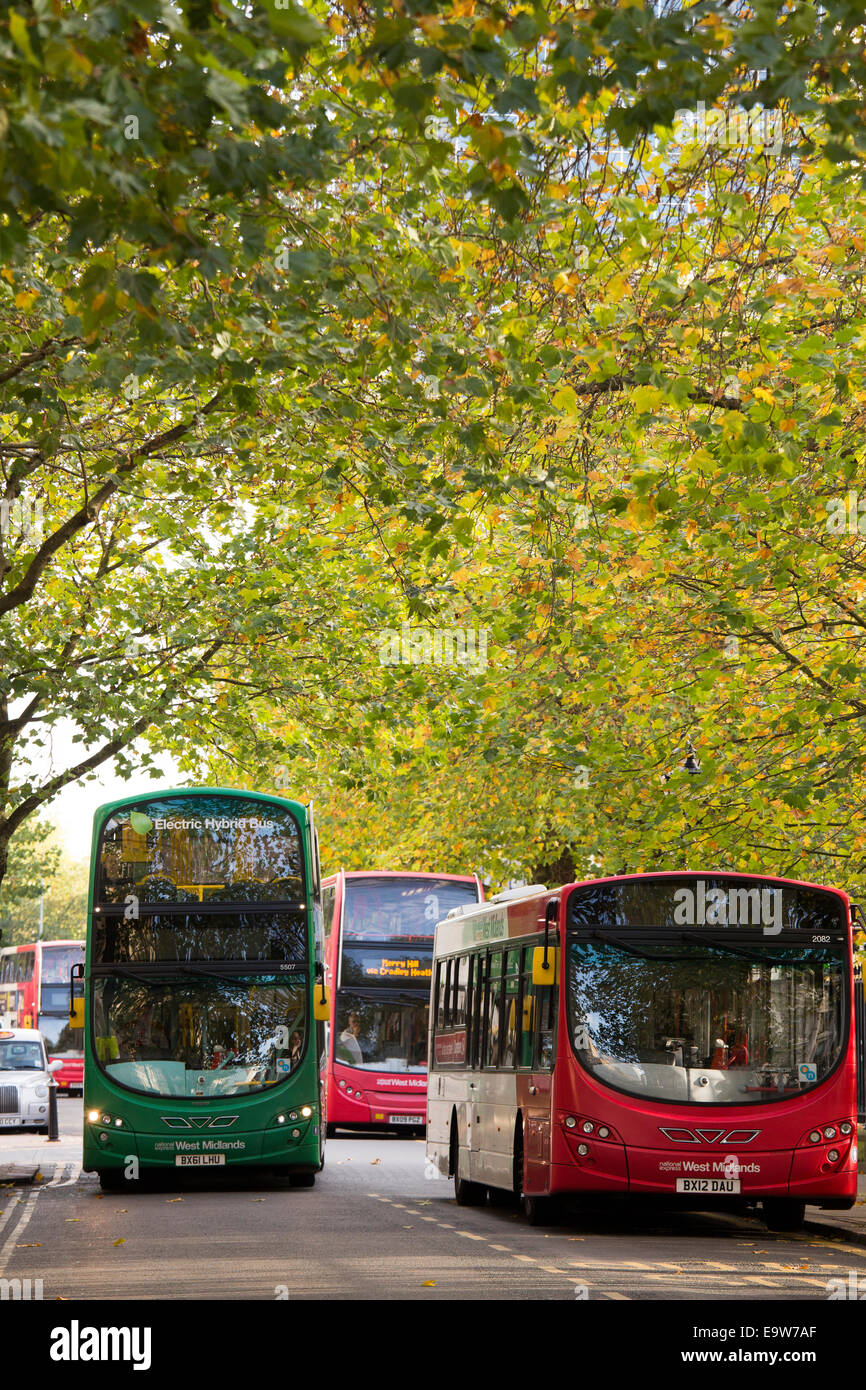 Public transport buses in the leafy Colmore Row area in the centre of Birmingham City Centre - Stock Image
