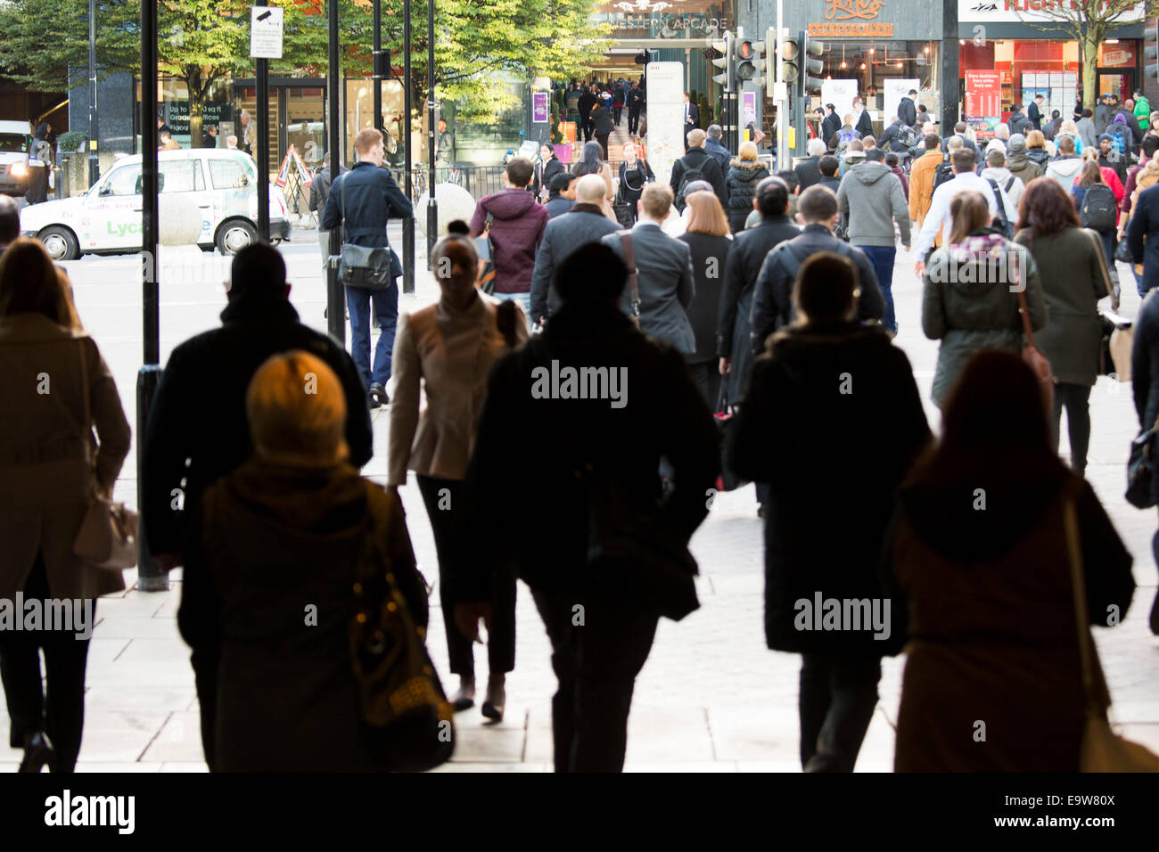 Commuters walking out of Snow Hill railway station towards the centre of Birmingham Stock Photo