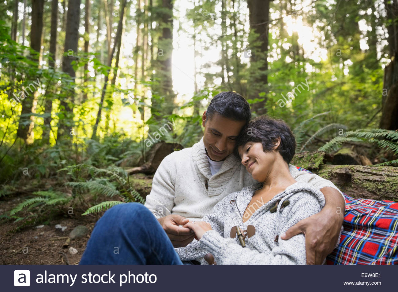 Romantic couple hugging in woods - Stock Image