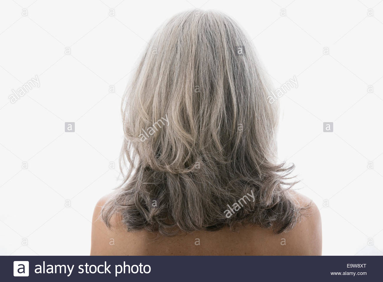 Rear view of senior woman with gray hair - Stock Image