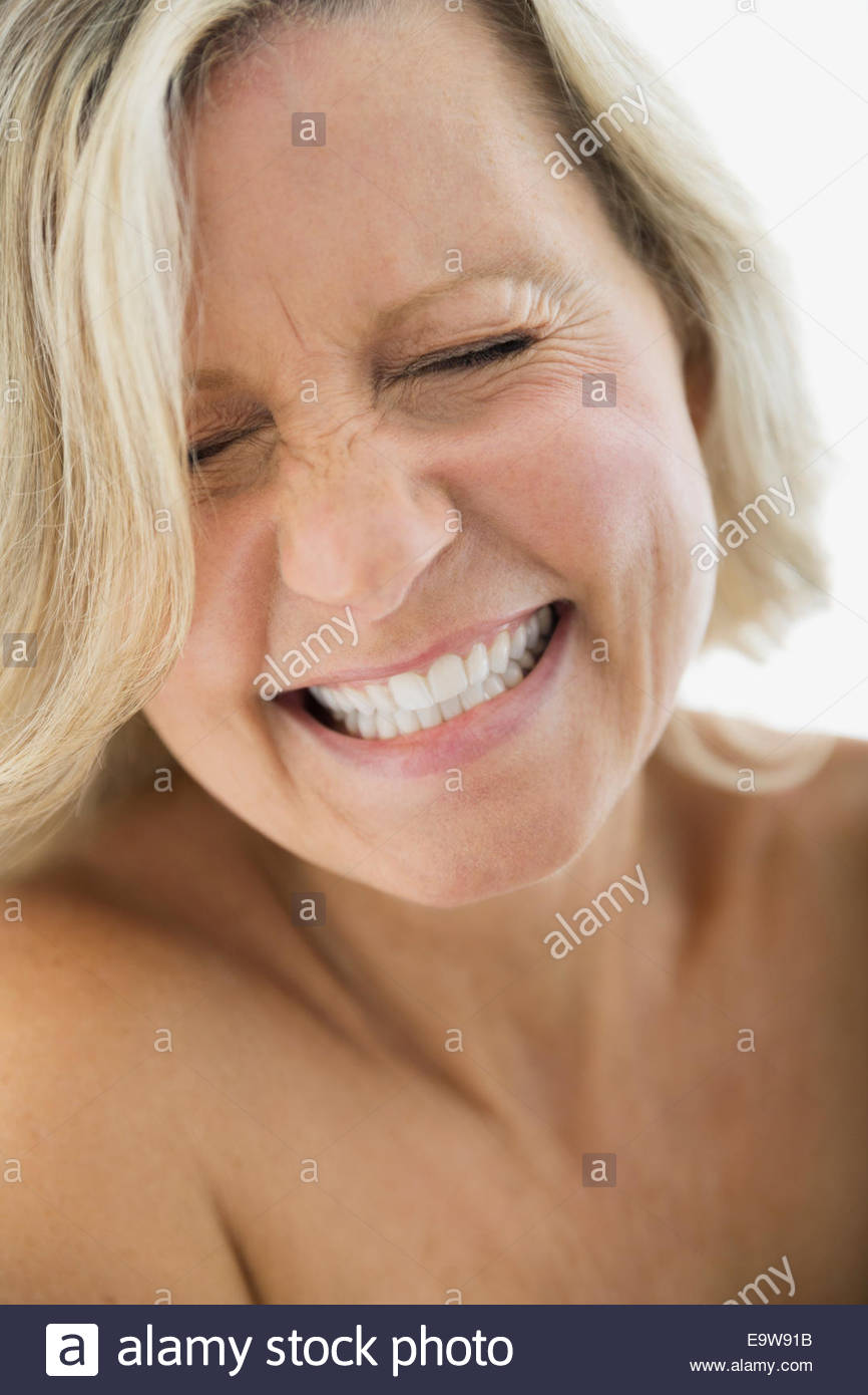 Close up portrait of enthusiastic blonde woman - Stock Image