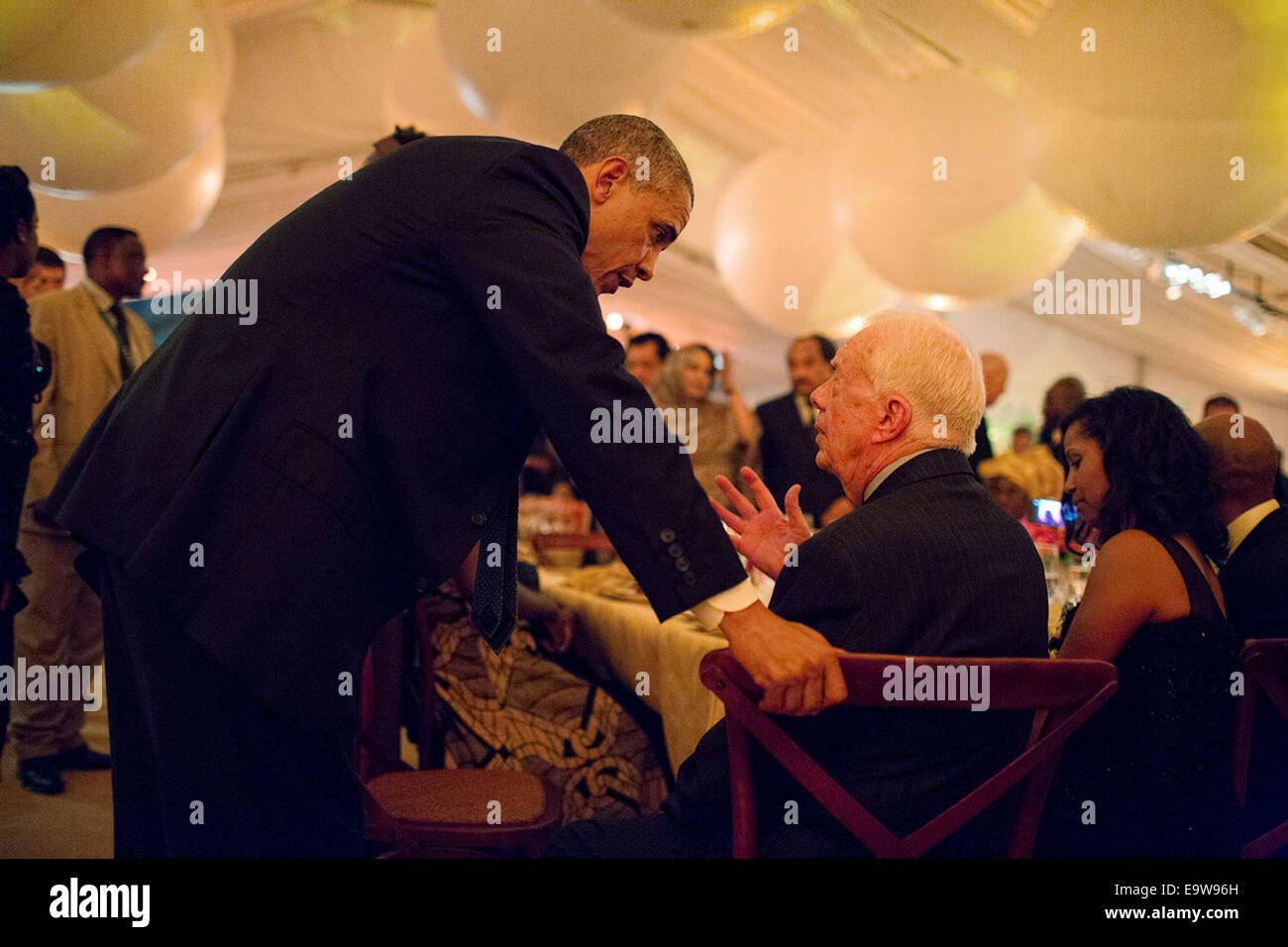 President Barack Obama talks with former President Jimmy Carter during the U.S.-Africa Leaders Summit dinner on the South Lawn of the White House, Aug. 5, 2014. Ph Stock Photo
