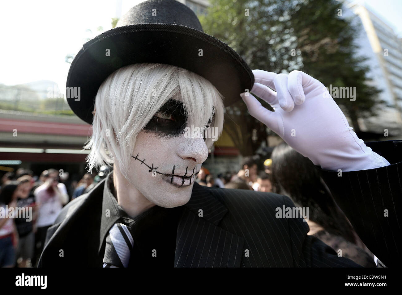 Sao Paulo, Brazil. 2nd Nov, 2014. A person wearing makeup poses during the Zombie Walk, in the context of the celebrations Stock Photo