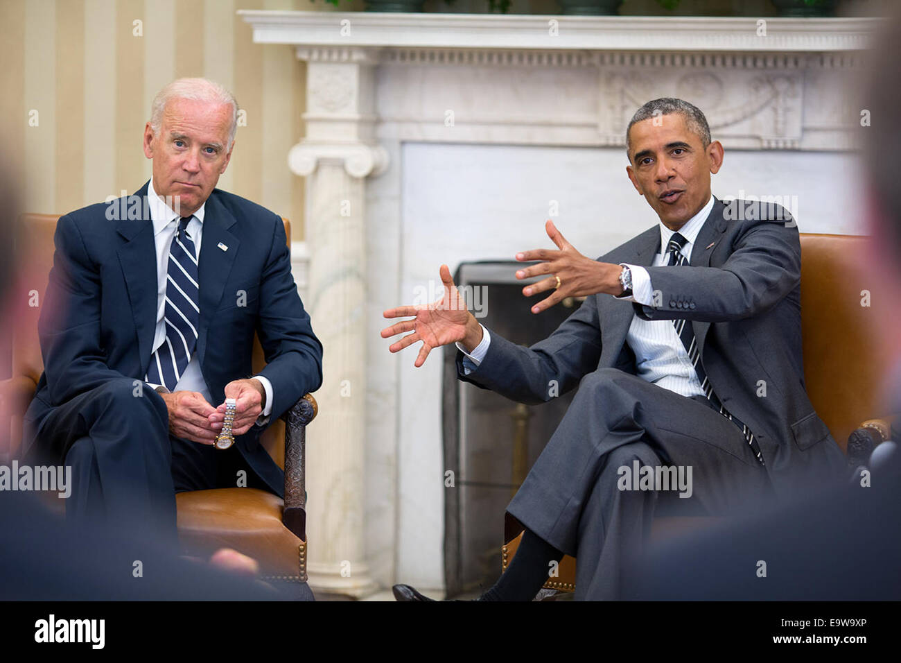 President Barack Obama gestures during a meeting with Vice President Joe Biden in the Oval Office, Aug. 27, 2014. - Stock Image