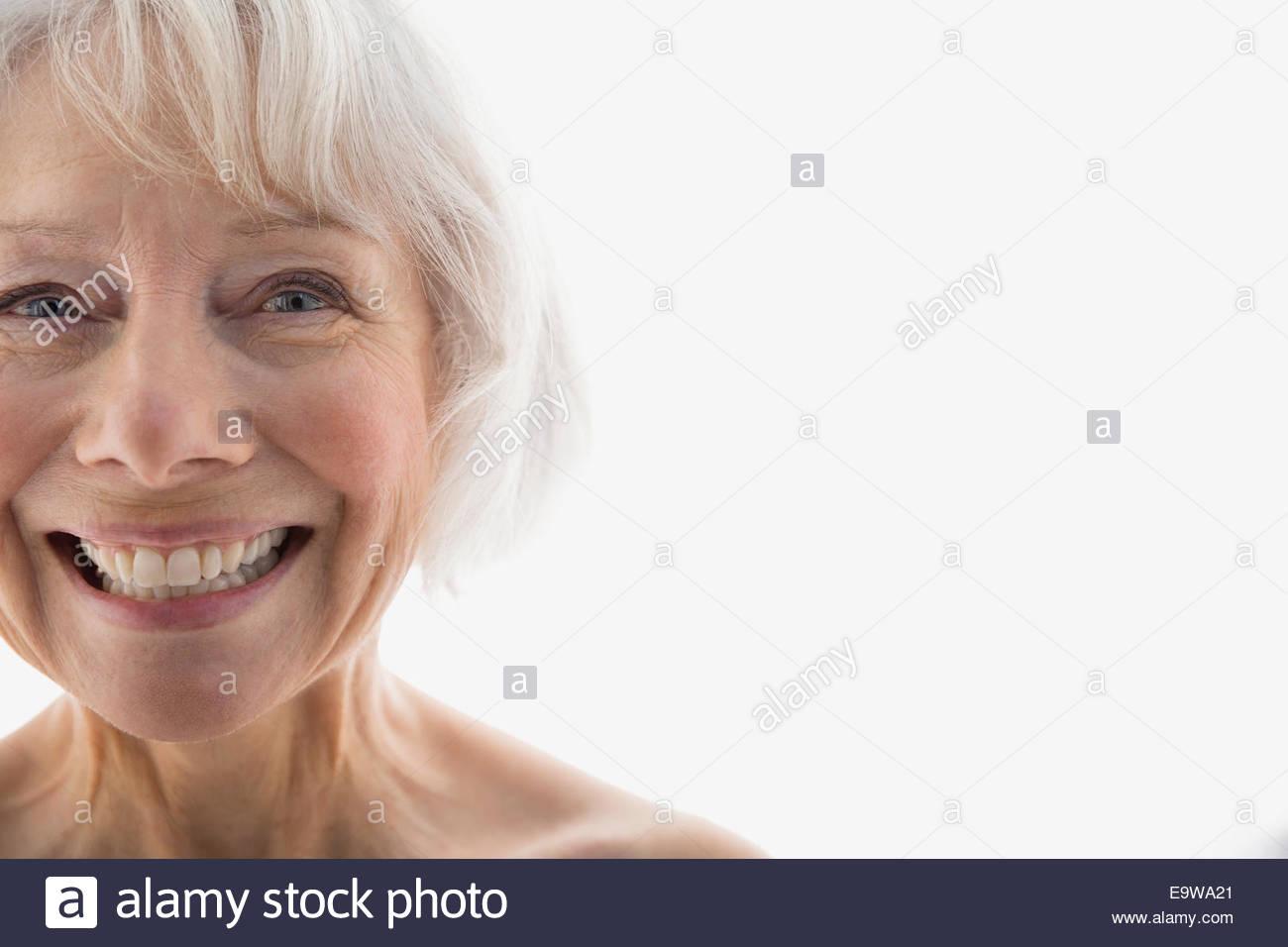 Close up portrait of enthusiastic senior woman - Stock Image