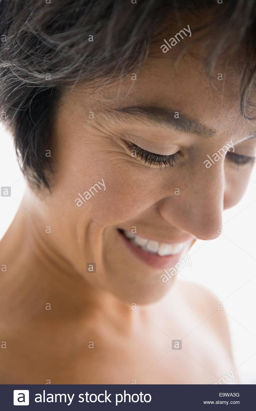 Close up of smiling woman with bare chest - Stock Image
