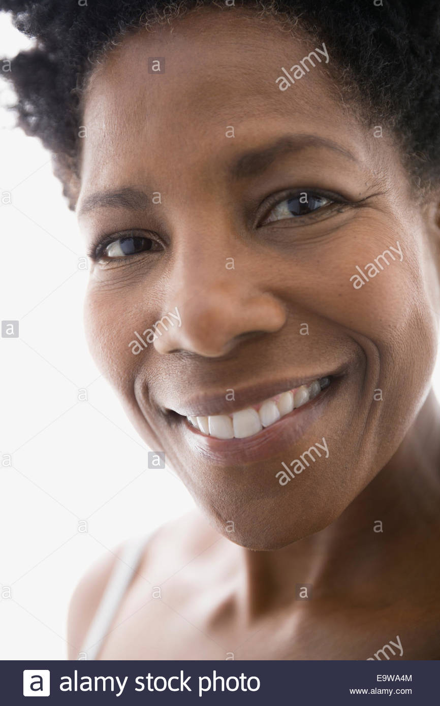 Close up portrait of smiling woman - Stock Image