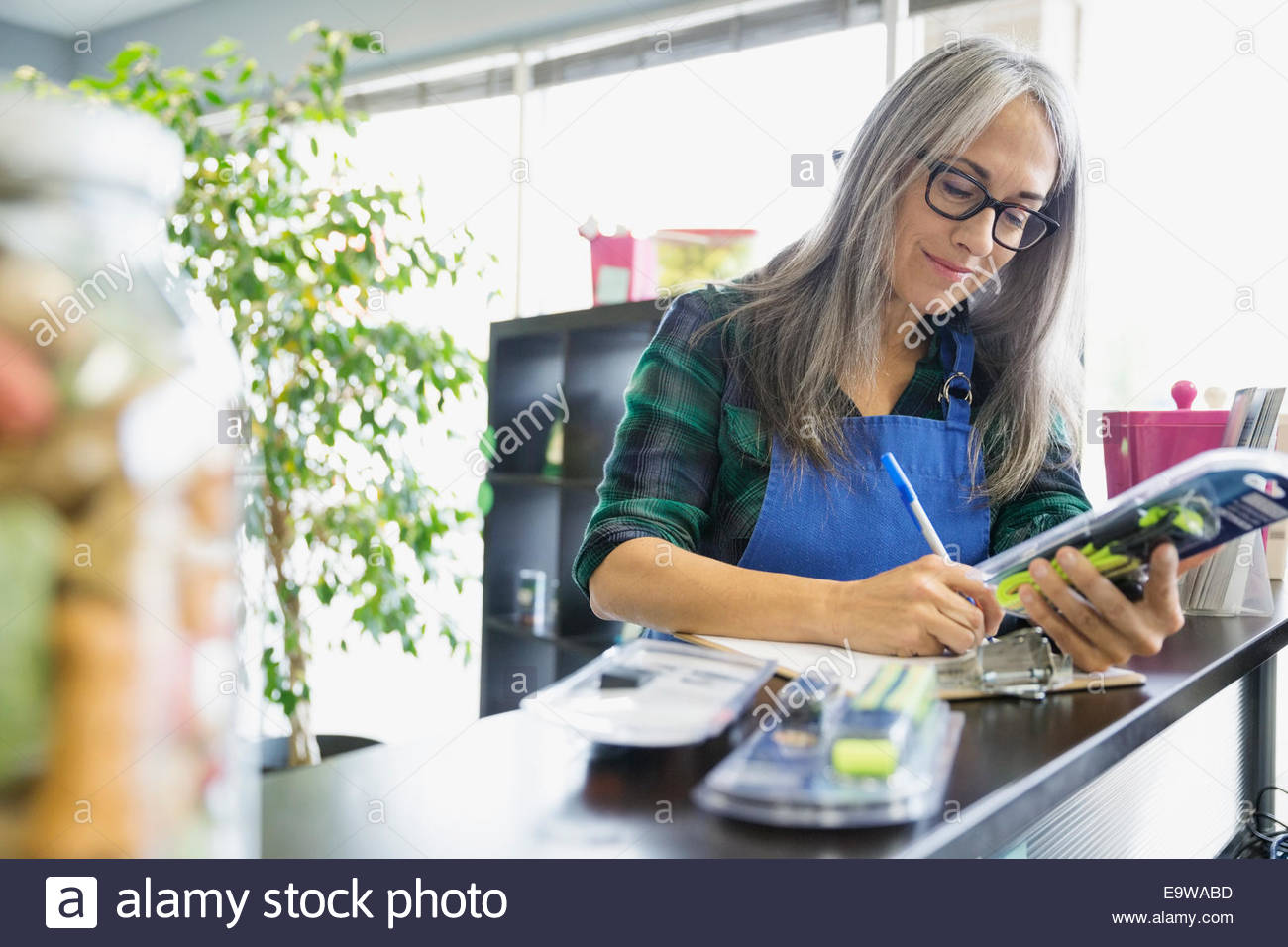 Dog daycare owner checking inventory - Stock Image