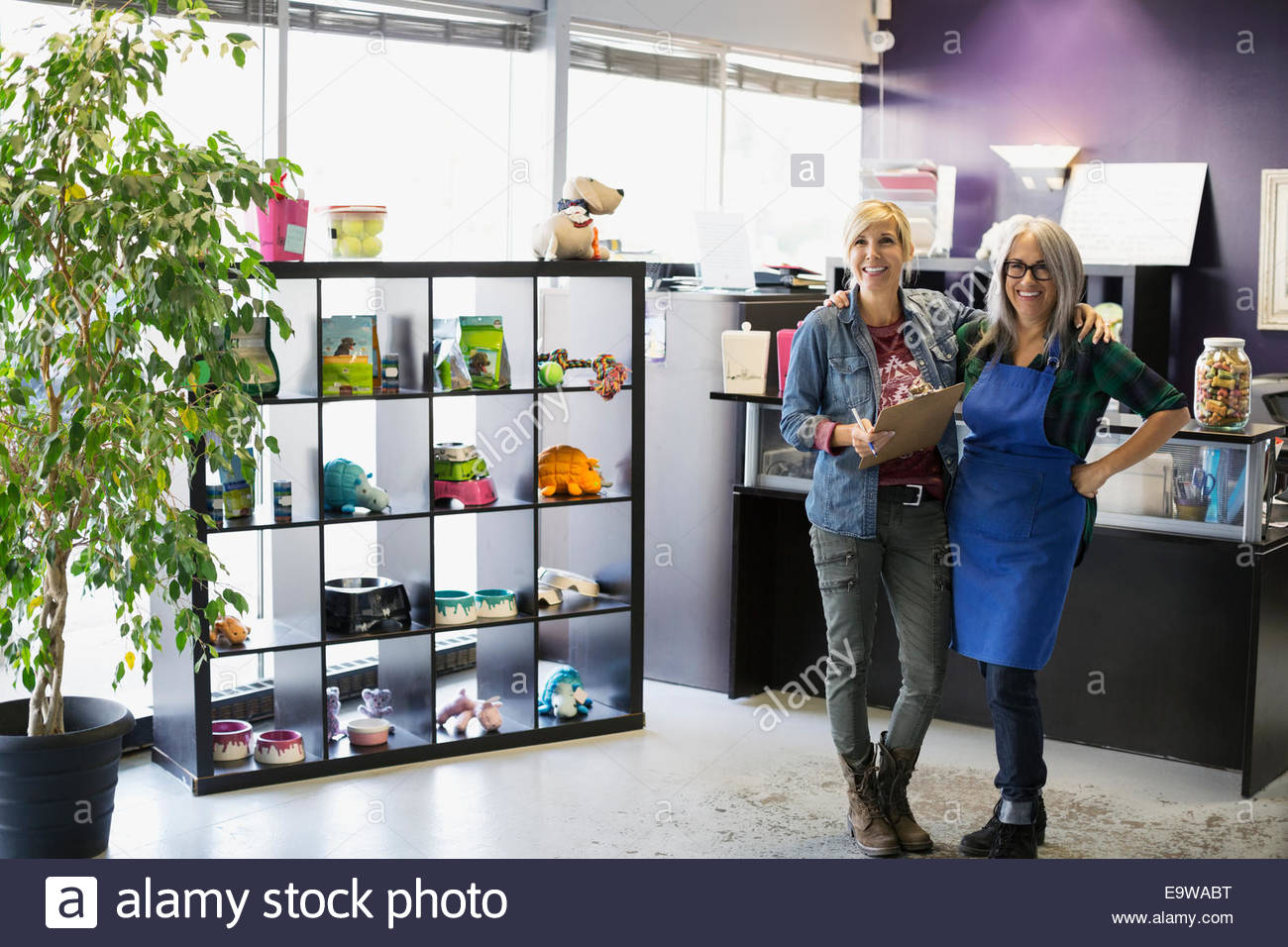 Portrait of confident dog daycare owners - Stock Image