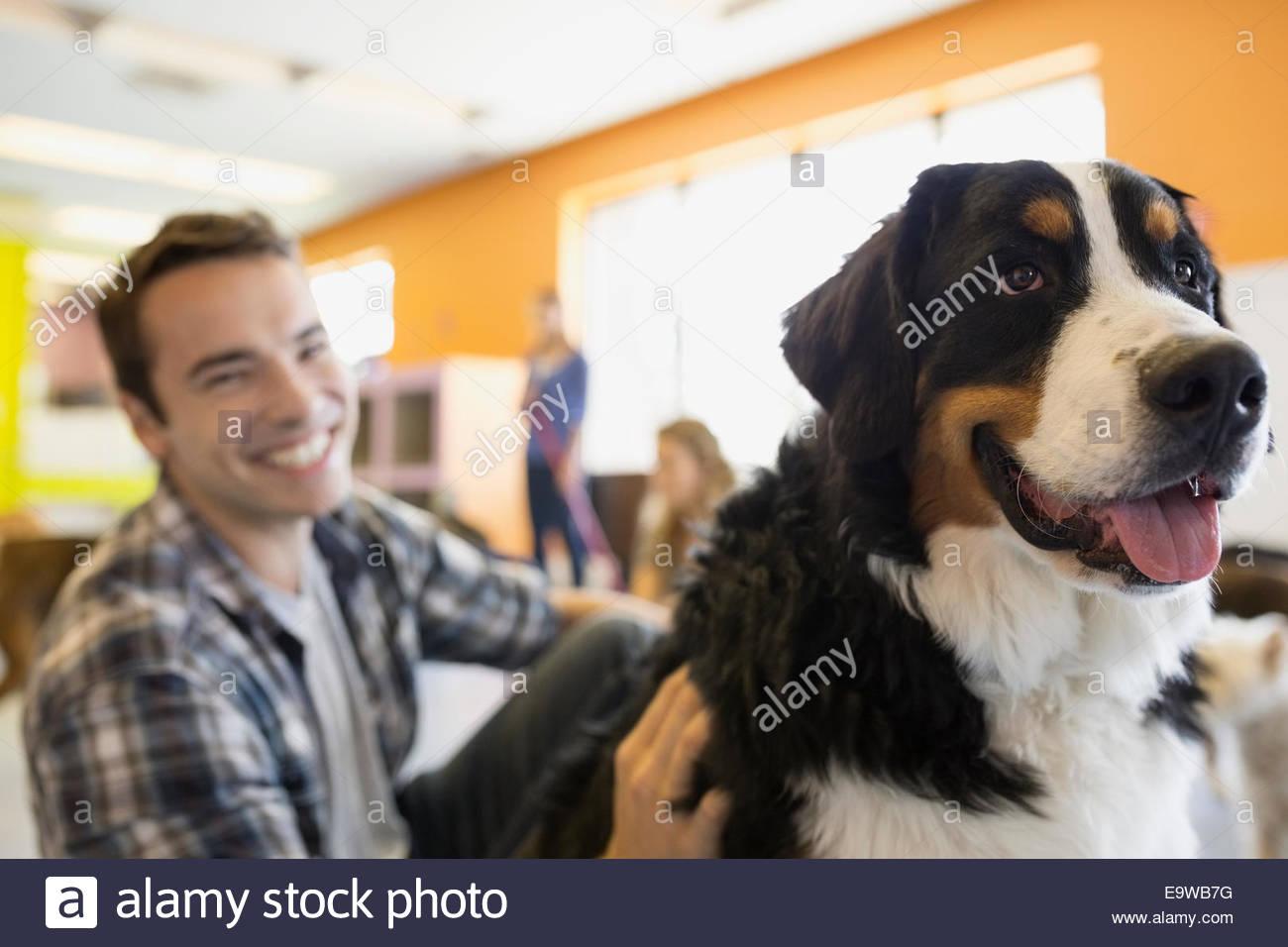 Portrait of smiling man with Saint Bernard dog - Stock Image