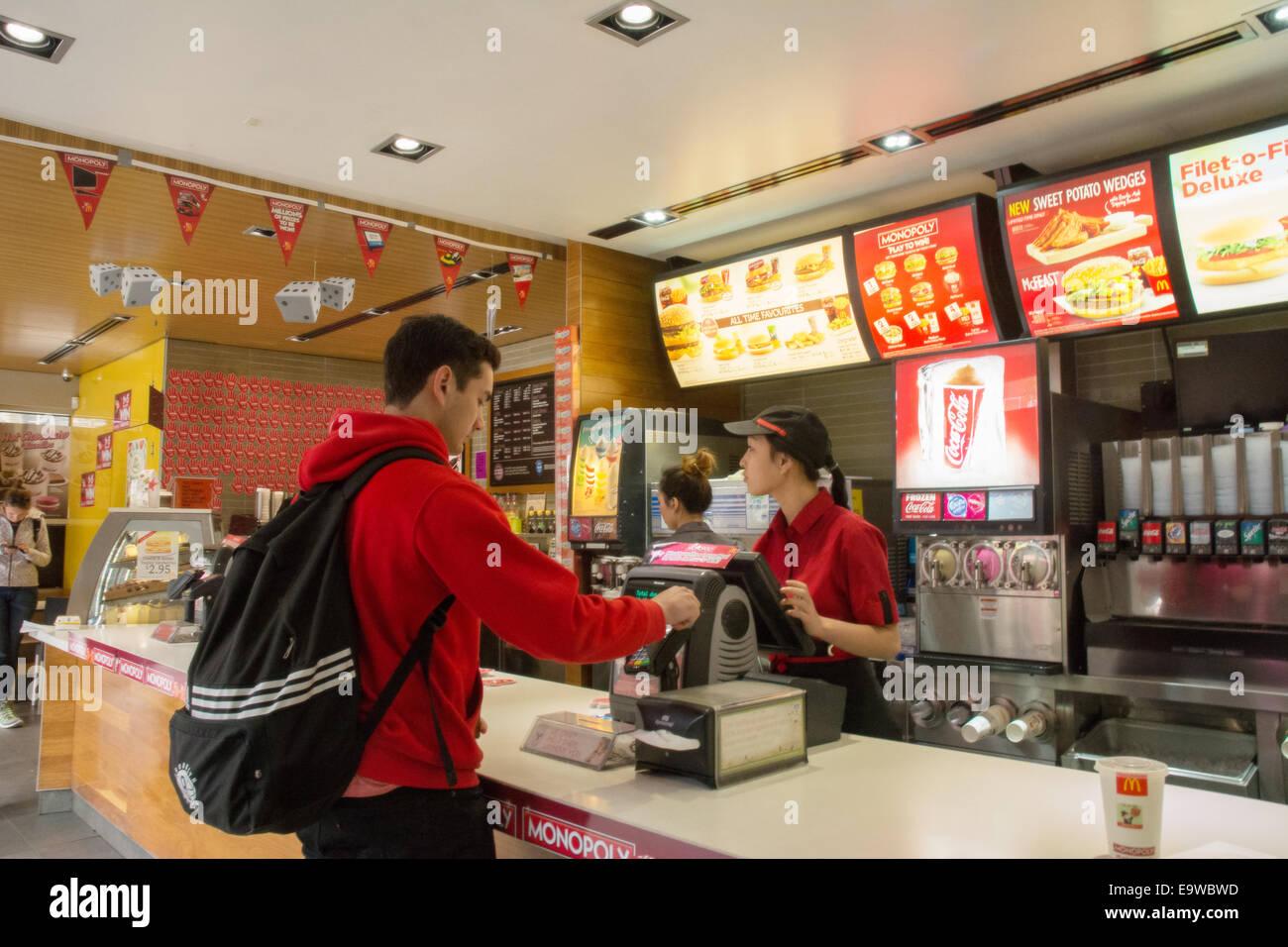 McDonald's sale transaction cashier fast food - Stock Image