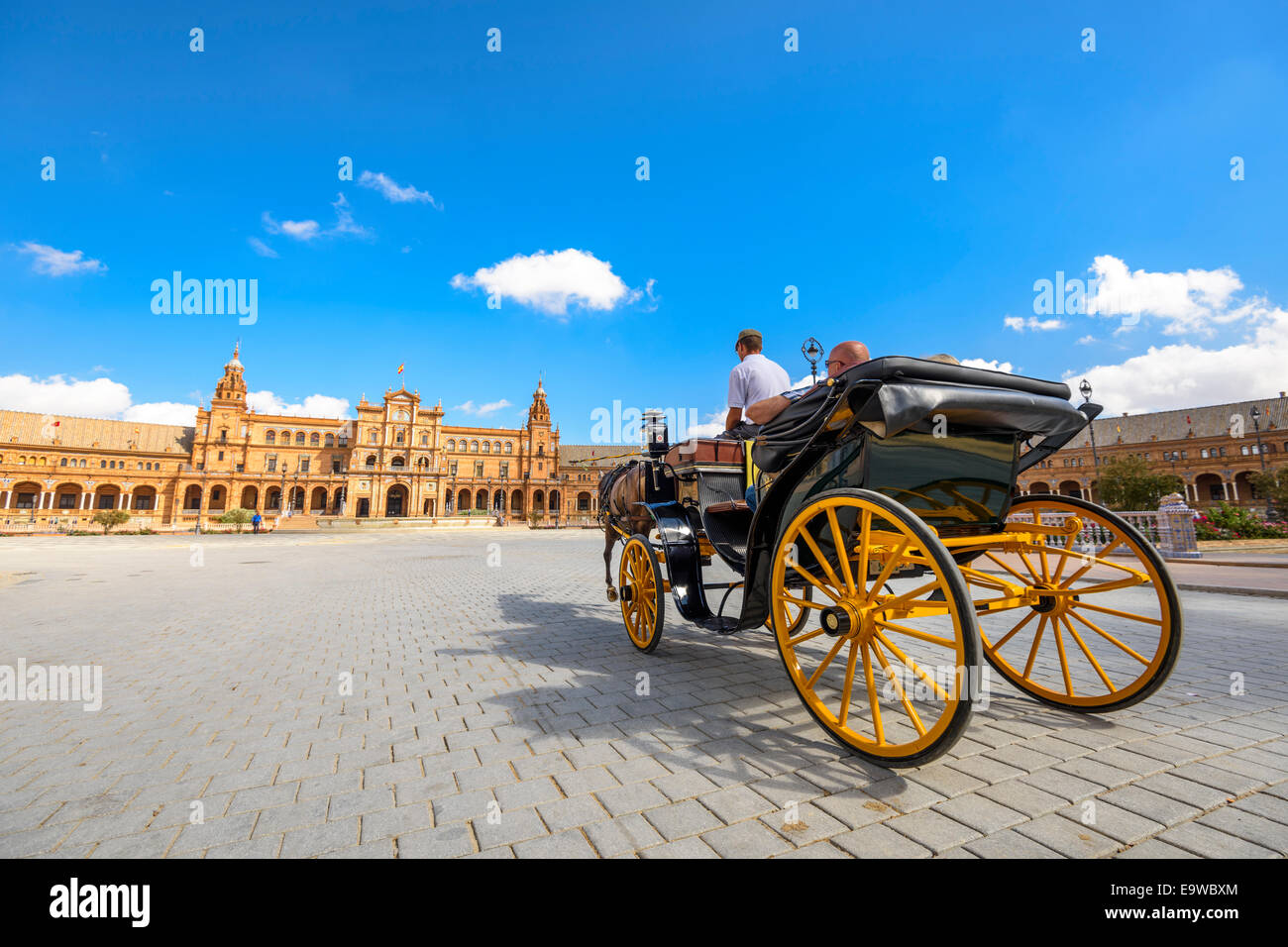 Seville, Spain. A horse drawn carriage tour through Spanish Square. - Stock Image