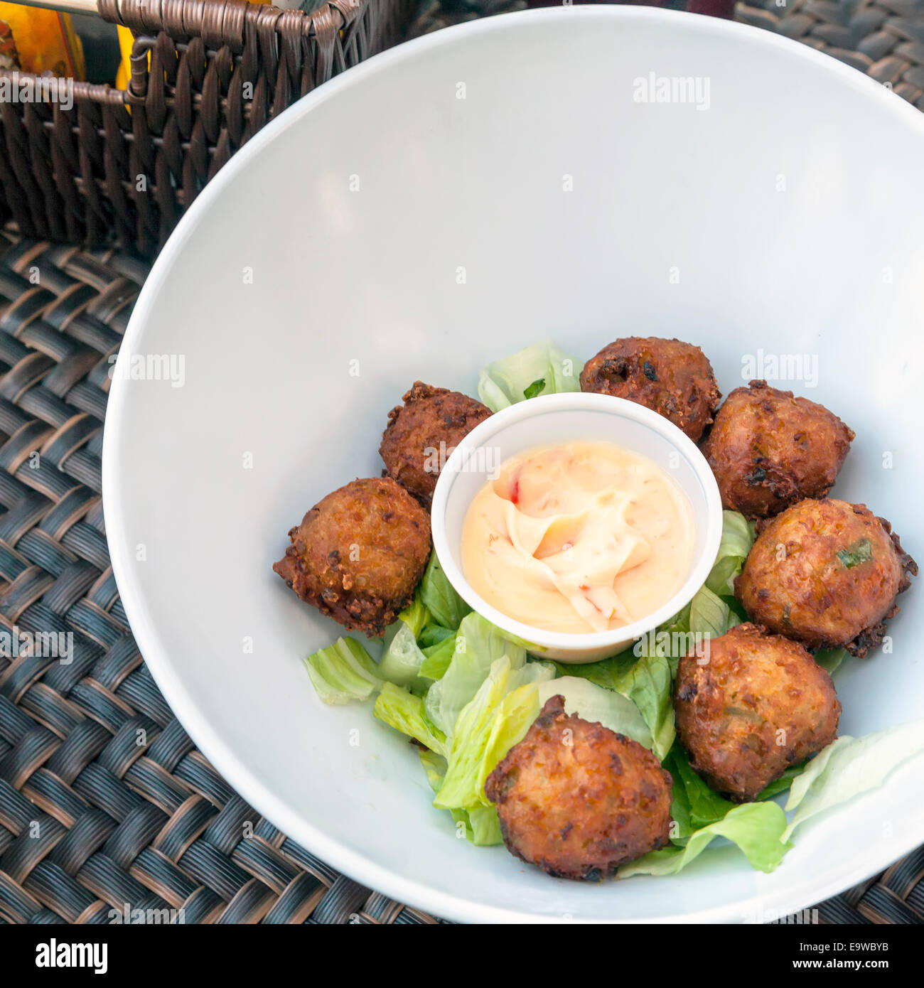 Spicy conch fritters on a bed of lettuce served with tangy chipotle sauce at the Sandbar Grille in Fort Lauderdale, - Stock Image
