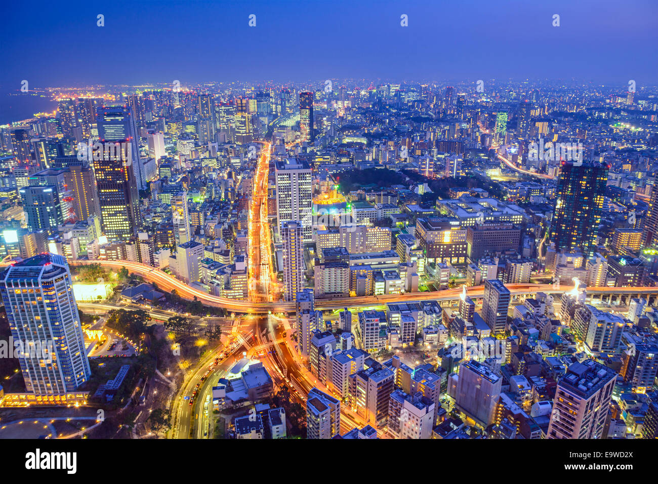 Tokyo, Japan cityscape at dusk above highway junction. - Stock Image
