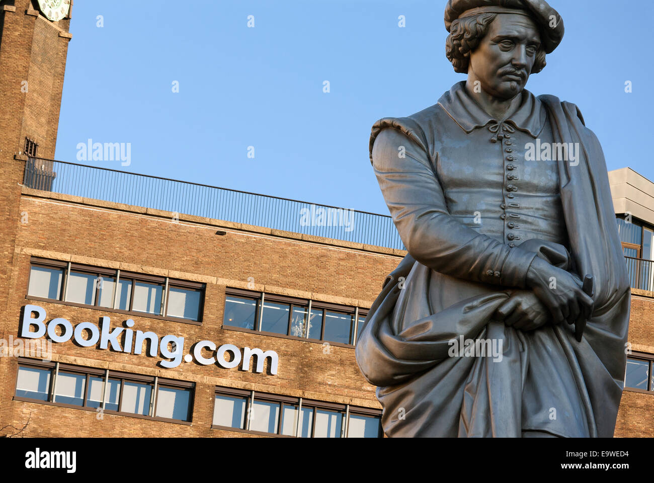 Booking.com HQ headquarters head office building on the Rembrandtplein Rembrandt Square with the statue of Rembrandt. - Stock Image