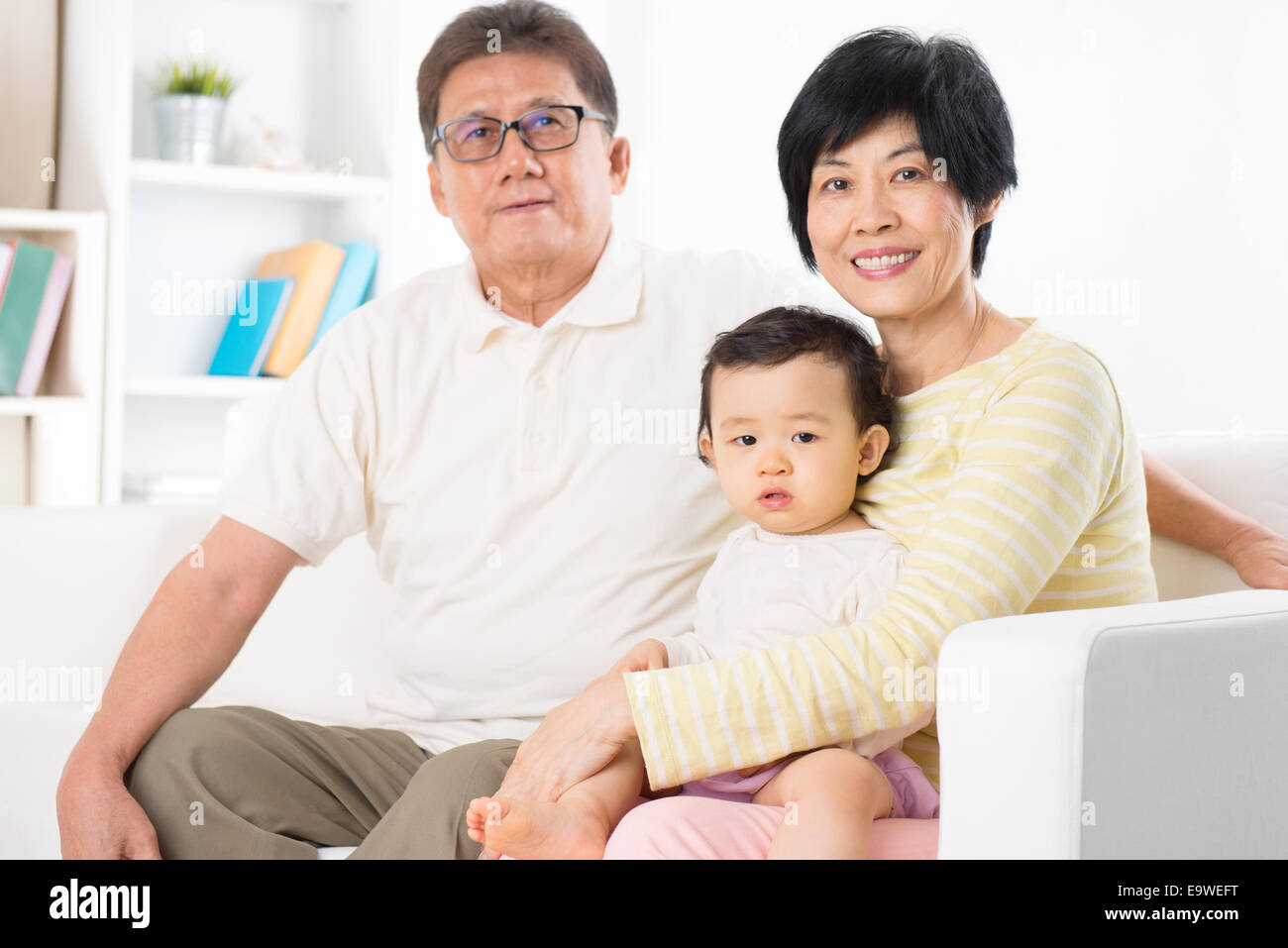asian family portrait relaxing at home grandparents and grandchild