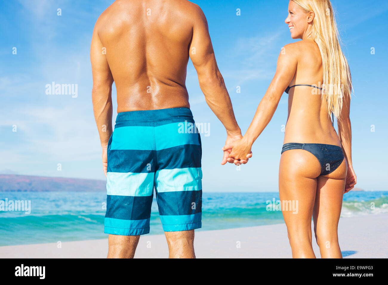Attractive Couple on Sunny Tropical Beach Vacation - Stock Image