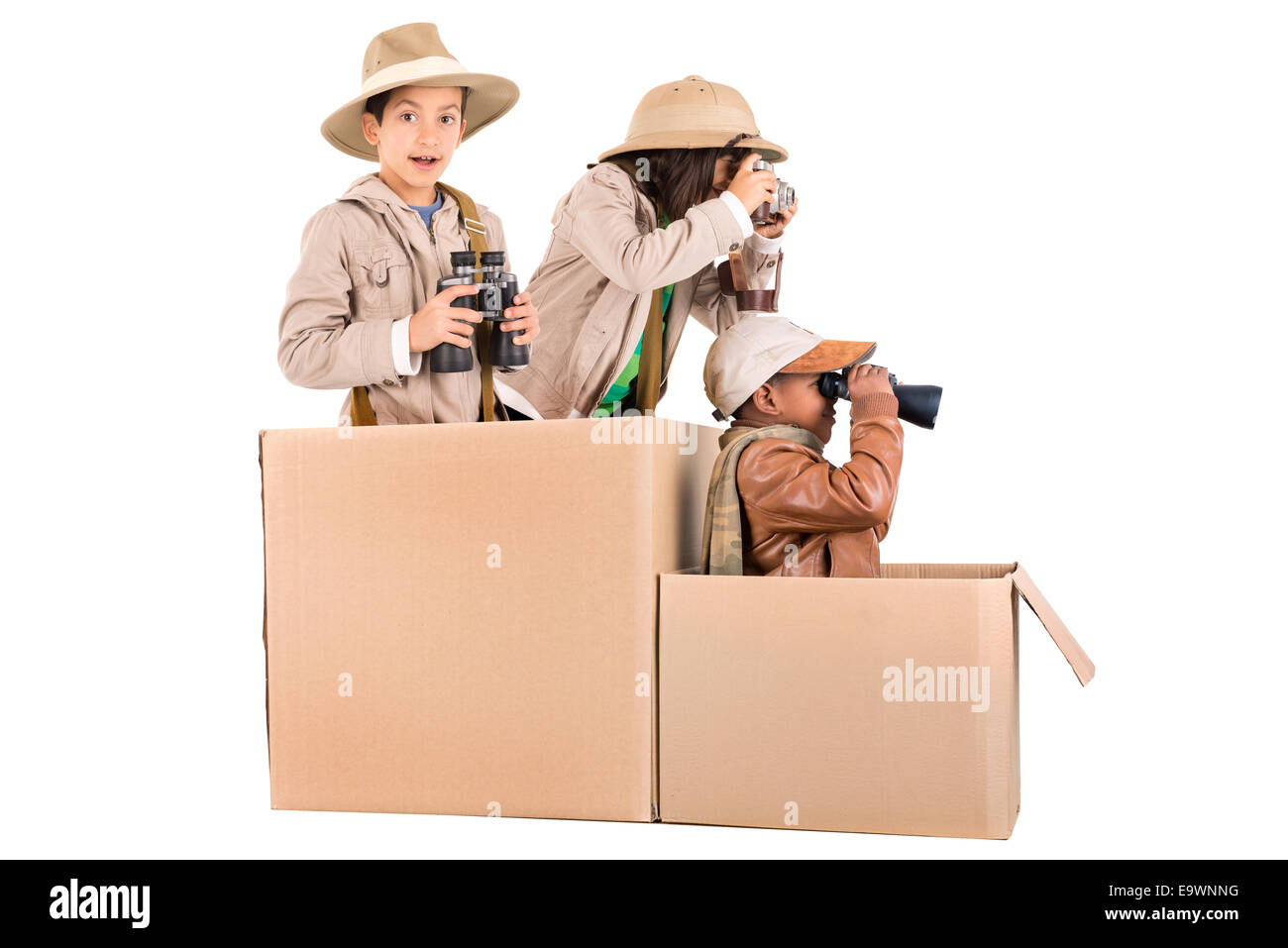 Children's group in a cardboard box playing safari - Stock Image