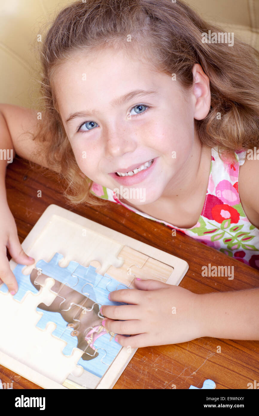 Young girl doing a jigsaw puzzle - Stock Image