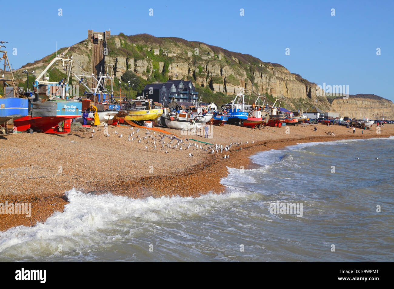 Fishing boats on Hastings Old Town Stade beach East Sussex UK. Hastings has the biggest beach launched fishing fleet - Stock Image