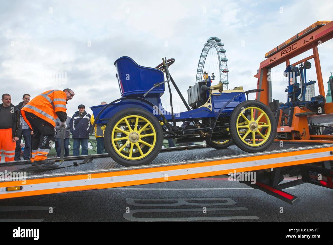 RAC truck attends breakdown of vintage car on Westminster Bridge, during The London to Brighton Veteran Car Run, - Stock Image