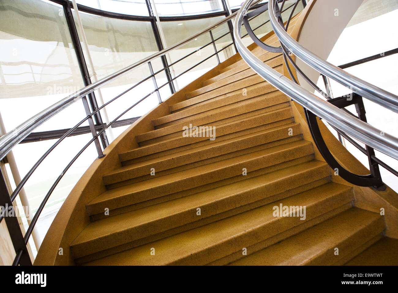 A wide curved stairway - Stock Image