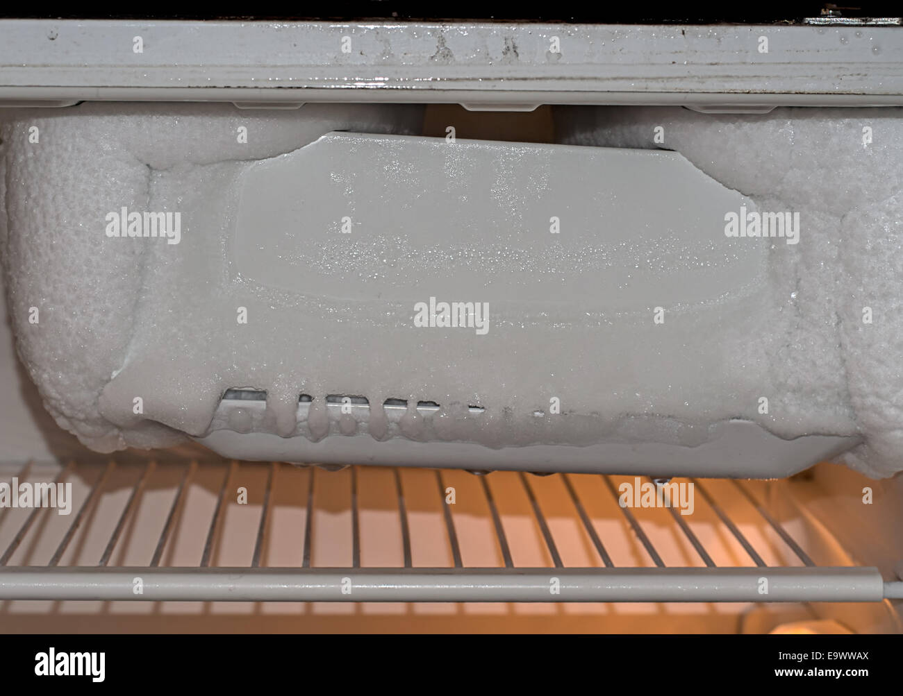 Domestic chore - defrost ice box fridge - Stock Image