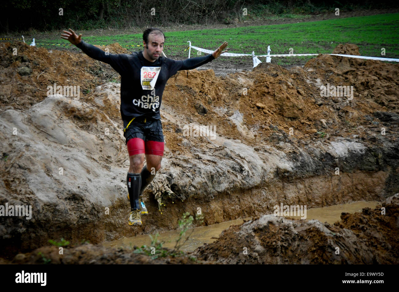 Participants battle against obstacles and mud in the 2014 Nuclear Races 'Fallout' event - Stock Image