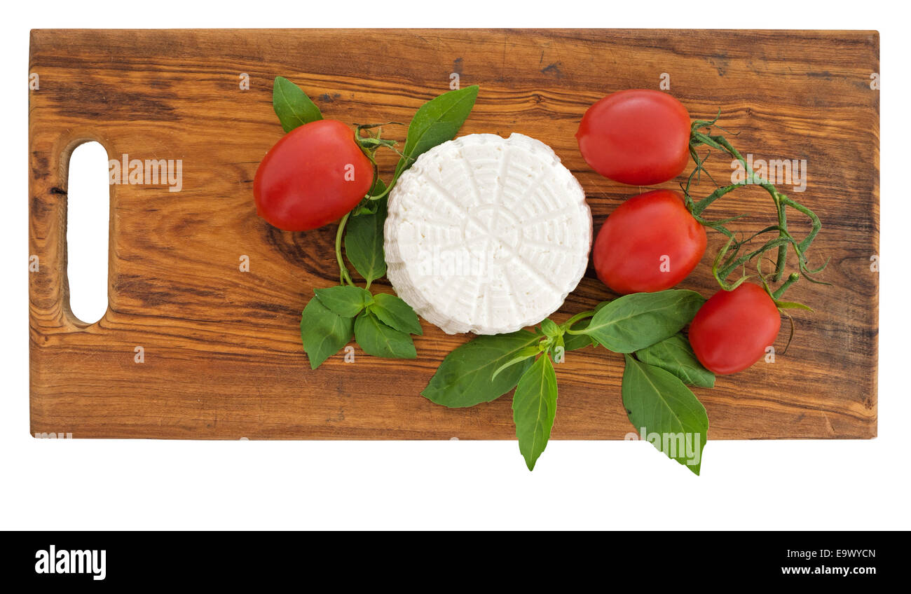 Fresh artisan ricotta cheese with tomatoes. Organic. - Stock Image